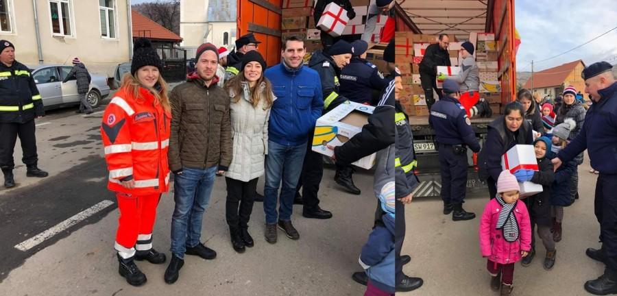 """Principele Nicolae, printre voluntarii care împart daruri în cadrul acțiunii """"Camionul de Crăciun"""""""