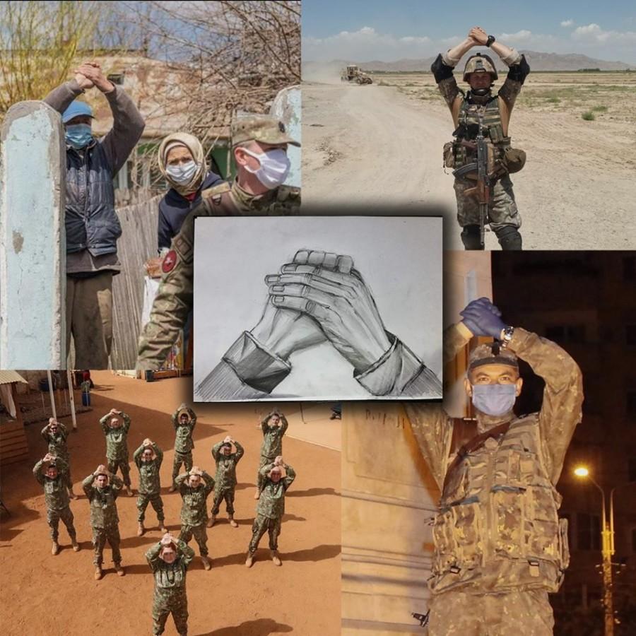 Gestul de recunoștință al unui bătrân, mâinile împreunate deasupra capului, simbol al unității preluat de toată Armata